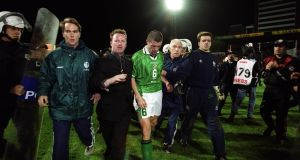 Roy Keane is escorted off the pitch after Ireland were eliminated from the Euro 2000 playoffs by Turkey amid farcical scenes in Bursa. Photo: Tom Honan/Inpho
