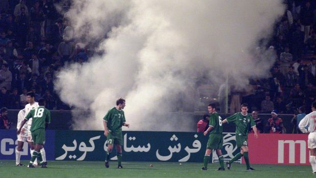 Flares go off in the crowd during the first leg of Ireland's playoff with Iran in 2001. Photo: Patrick Bolger/Inpho
