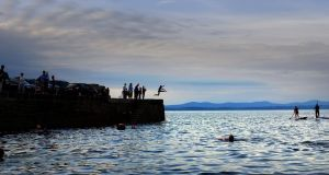 Pier jumpers enjoying the weather in Creevy, Co Donegal. The tourism industry expressed relief after retaining its special 9 per cent VAT rate. Photograph: Bryan O'Brien/The Irish Times.