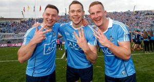 Dublin's Philip McMahon, Dean Rock and Ciarán Kilkenny celebrate the three-in-a-row after the victory over Mayo in the All-Ireland final. Photograph: James Crombie/Inpho