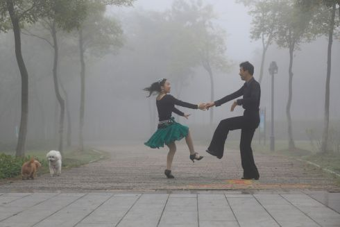 MIST CONNECTION: People dance in a park on a foggy day in Huai'an, Jiangsu province, China. Photograph: Stringer/Reuters