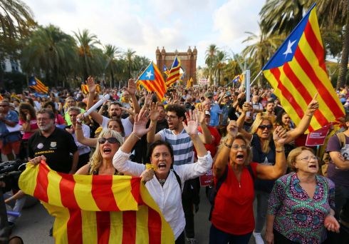 CATALAN INDEPENDENCE: People wave separatist Catalan flags at a rally in support of independence, in Barcelona. Photograph: Ivan Alvarado/Reuters