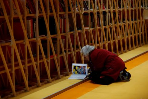 OPEN BOOK: A woman reads a book on the floor during a book fair in Frankfurt, Germany. Photograph: Ralph Orlowski/Reuters