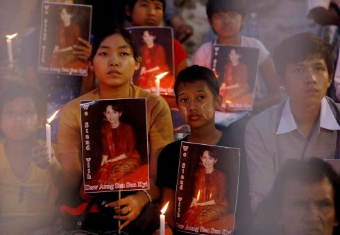 MYANMAR CEREMONY: People hold photos of Myanmar state counsellor Aung San Suu Kyi during a ceremony of interfaith praying, in Yangon. Photograph: Soe Zeya Tun/Reuters
