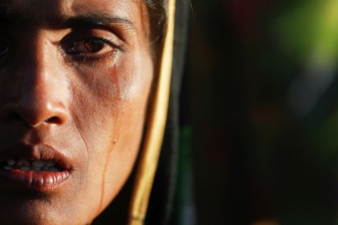 ROHINGYA CRISIS: Amina Khatun, a 30-year-old Rohingya refugee, cries after spending a night by the road, near Cox's Bazar, Bangladesh. Photograph: Damir Sagolj/Reuters