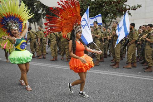MARCH FOR ISRAEL: Brazilian Christian pilgrims walk past Israeli soldiers during an annual support march for Israel in Jerusalem. Photograph: Menahem Kahana/AFP/Getty Images