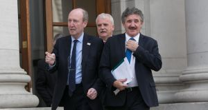 Independent Alliance members Shane Ross, Finian McGrath and John Halligan at Government Buildings after the budget. Photograph: Gareth Chaney Collins