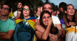 Pro-independence supporters  watch on broadcast screens outside the Catalan parliament as regional president Carles Puigdemont outlines his government's response to  the referendum result  of  October 10th. Photograph: Jeff J Mitchell/Getty Images