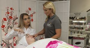 Ciara Daly, a trainee beauty therapist, and Tara O'Halloran, who runs the beauty therapy traineeship at Kerry Education and Training Board.  Photograph: Kevin Mulcahy