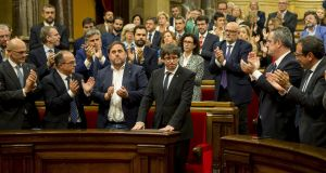 Catalan president Carles Puigdemont  is applauded after  addressing the region's parliament in Barcelona. Photograph: Quique Garcia/EPA