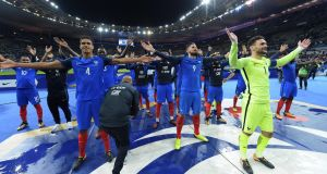 France celebrate World Cup qualification after their 2-1 win over Belarus at the Stade de France. Photograph: Christophe Simon/AFP'