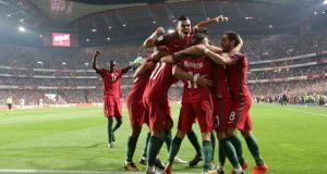 Portugal celebrate after Andre Silva's strike gave them a 2-0 lead against Switzerland. Photograph: Armando Franca/AP