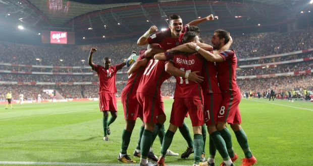 d8bb24408b Portugal celebrate after Andre Silva s strike gave them a 2-0 lead against  Switzerland.