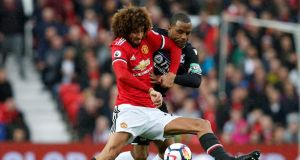 Manchester United's Marouane Fellaini will miss their trip to Anfield. Photograph: Reuters