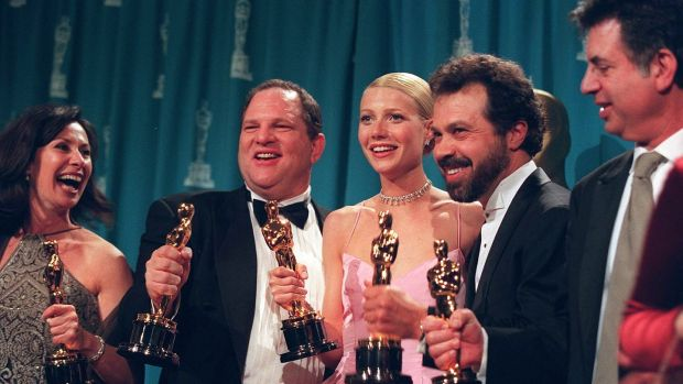 Harvey Weinstein, second from left, celebrates alongside Gwynneth Paltrow and other producers of Shakespeare in Love after it won the best picture Oscar in 1999. Photograph: Monica Almeida/The New York Times