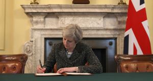 Brexit: Theresa May signs the official letter invoking article 50, in March. Photograph: Christopher Furlong/Getty