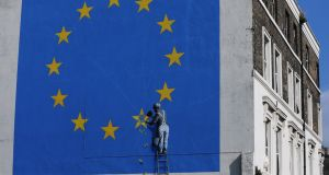 Banking union: A mural by street artist Banksy depicting a European Union (EU) flag being chiseled by a workman on the side of a building in Dover, England, last month. Photograph: Luke MacGregor/Bloomberg.