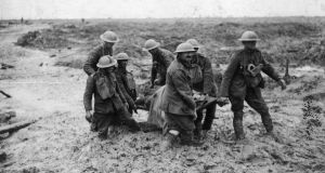 Stretcher-bearers carry a wounded soldier through the mud near Boesinghe during the battle of Passchendaele in Flanders. Photograph: John Warwick Brooke/Getty Images