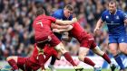 Leinster's Tadhg Furlong is  tackled during their victory over Munster on Saturday. Photograph:  Billy Stickland/Inpho