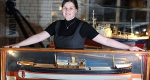 Guinness archivist Eibhlin Roche with a model  of the 'WM Barkley'