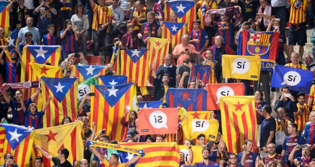 ded9a8d0e Football fans hold Catalan flags before FC Barcelona s match with Girona at  the Estadi Montilivi.