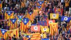 Football fans hold Catalan flags  before FC Barcelona's match with Girona at the Estadi Montilivi. Photograph: Josep Lago/AFP/Getty Images