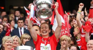 Cork captain Rena Buckley lifts the O'Duffy Cup after the All-Ireland camogie win over Kilkenny. Photograph: James Crombie/Inpho