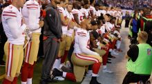 Members of the San Francisco 49ers kneel during the playing of the national anthem. Photograph: PA