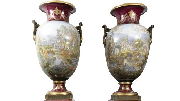 A pair of mid-19th century Sèvres vases painted with classical landscapes