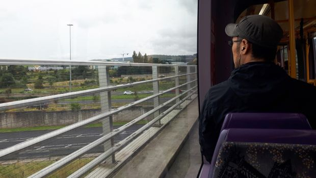 A passanger looks out from the Luas while travelling on the green line. Photograph: Aidan Crawley