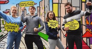 UCD students' union president Katie Ascough (pictured second from right) in a promotional picture released as part of her campaign against an  impeachment bid.