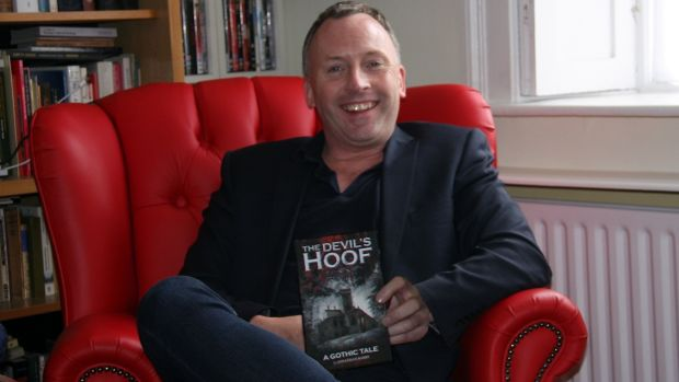 Jonathan Barry with his novel, The Devil's Hoof
