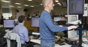 Stand-up guy: Justin Comiskey at his standing desk in the Irish Times newsroom. Photograph: Dave Meehan