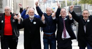 Apple for Athenry: A group  supporting the planned Apple data centre in Galway celebrate after the judicial review rejected both challenges to  the project. Photograph: Courtpix