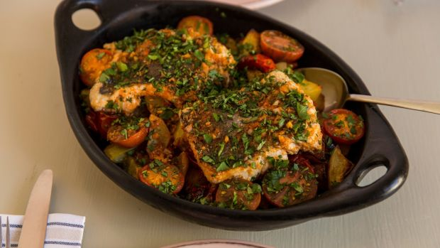 Oven roasted fish with potatoes and tomatoes. Photograph: Emma Jervis
