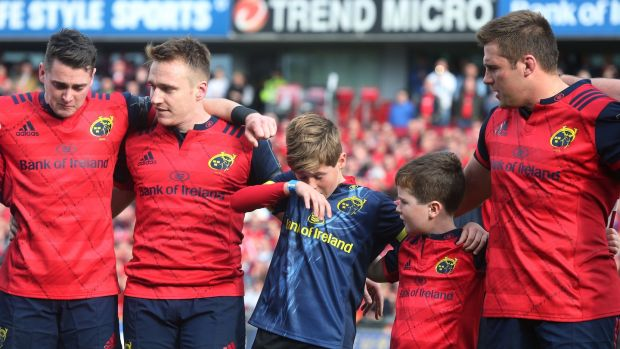Anthony Foley's sons Tony and Dan with Munster players after the European Champions Cup match against Glasgow Warriors at Thomond Park on October 22nd. Photograph: Lorraine O'Sullivan/PA Wire