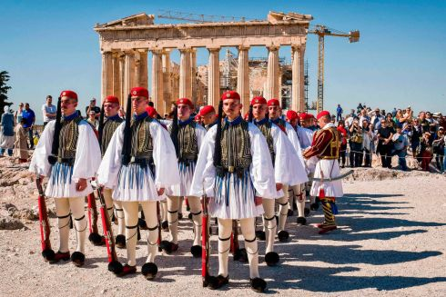FREEDOM FROM GERMANY: Greek presidental Evzoni Guards at the Parthenon temple during a ceremony to mark the anniversary of the liberation of Athens from Nazi occupation. Photograph: Louisa Gouliamaki/AFP/Getty