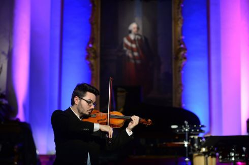 STRING TO HIS BOW: David McElroy of Cork School of Music prepares for the semi-final of the Irish Freemasons Young Musician of the Year competition. The final takes place on Saturday.  Photograph: Dara Mac Dónaill