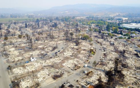 CALIFORNIA WILDFIRES: Damage in the town of Santa Rosa. At least 23 people have died, and 3,500 buildings have been destroyed, in the state so far. Photograph: DroneBase/Reuters