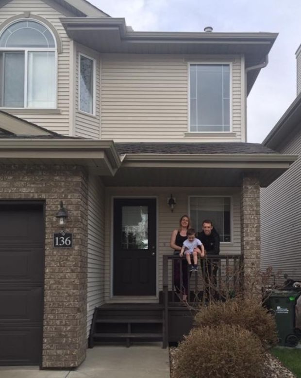 Katie Kiernan with her partner Shane and son Nathan outside their new home.