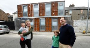 Shipping Container House: Gordon and Maggie Kelley with their children Gordie (7) and Penny Bell (eight months), at their house built from shipping containers at Ringsend , Dublin. Photograph: Eric Luke/The Irish Times