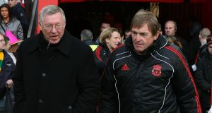 Alex Ferguson of Manchester United speaks with Kenny Dalglish of Liverpool ahead of the FA Cup match at Old Trafford in 2011. Photograph: John Peters/Man Utd via Getty Images