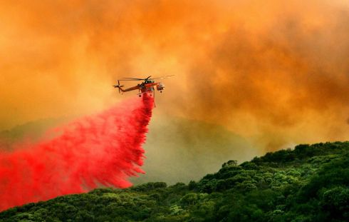 CALIFORNIA WILDFIRES: A fire-service helicopter drops flame retardant in Santa Barbara County. Photograph: EPA