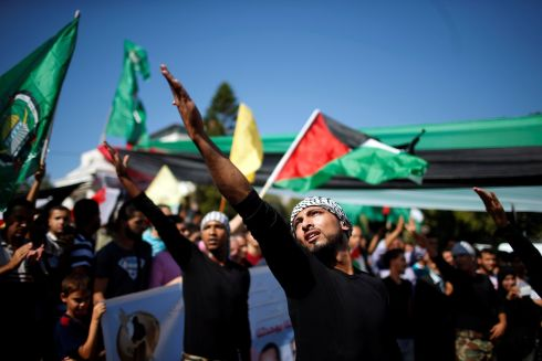 MIDDLE EAST DEAL: Palestinians celebrate after Hamas said it had reached an agreement with its rival Fatah over control of Gaza. Photograph: Suhaib Salem/Reuters