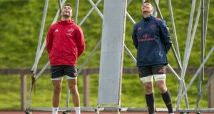 Conor Murray and Peter O'Mahony enjoy a lighthearted moment at Munster squad training in Limerick. Photograph: Morgan Treacy/Inpho