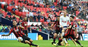 Tottenham's Christian Eriksen  scores during the Premier League game against Bournemouth at Wembley Stadium. Photograph: Andy Rain/EPA