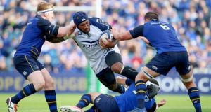 Leinster's James Tracy, Noel Reid and Rhys Ruddock tackle Nemani Nadolo of Montpellier during the Champions Cup game at the RDS. Photograph: Tommy Dickson/Inpho