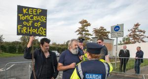 "Protesters at the opening of an ""Ideal Org"" Irish base by the Church of Scientology in Firhouse, on the site of the former Victory Centre. Photograph: Dave Meehan/The Irish Times"