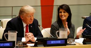 US ambassador the the UN Nikki Haley with US president Donald Trump. She said on Sunday: 'What we're saying now with Iran is don't let it become the next North Korea.' Photograph: Kevin Lamarque/Reuters