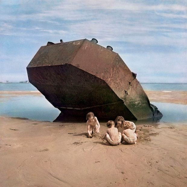 David Seymour's photograph of children at play beside abandoned landing craft on the beaches of Normandy, 1947 in Magnum Manifesto, Thames & Hudson (2017).
